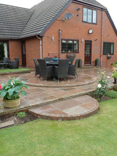 Natural Stone Patio Incorporating Lights and Planting