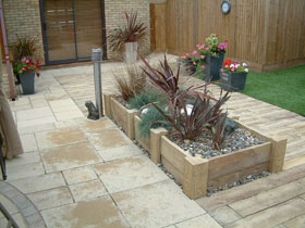 Woodstone Planters and Posts by Cotswold Paving & Lndscping