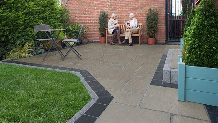 Pavesys Paving, Grey Green with Drivesys Riven Stone Basalt and Drivesett Argent Edging, Dark