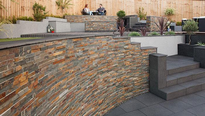 Stoneface Drystack, Copper Slate. Coping is SYMPHONY, Dark paving cut to size