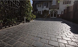 Split Stone Driveway with Curving Contrast Border